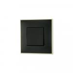 Prekidac crne boje sa toniranim okvirom sa metalnim efektom zlata za uređenje stana. Detalj koji oplemenju prostor!